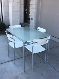 Table and chairs: glass top, metal base, 4 stacking plastic chairs Ashburn, 20147