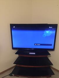 black flat screen TV with black wooden TV stand Fort Smith, 72908