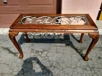 rectangular brown wooden framed glass top coffee table Montreal, H4G 2Y7