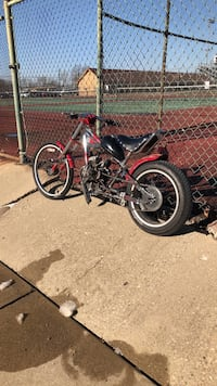 Black and red motorized bike