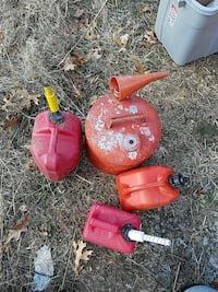 two red and orange gas cans