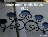 black ornate metal candle holder with $5.00 text overlay York, 29745