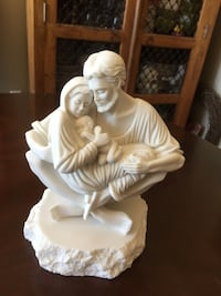 Couple carrying their baby figurine sacred family