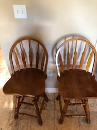 Two brown wooden windsor chairs 469 mi
