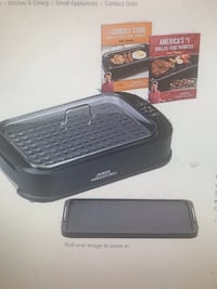 black and gray Bose portable speaker with box 1212 mi
