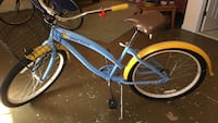 blue and yellow cruiser bicycle Sterling, 20165