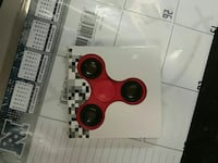 red fidget spinner with box 68 km