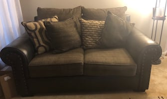 Brown love seat and sofa