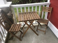 brown wooden table with two chairs