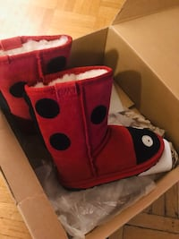 pair of red-and-black rain boots 782 km