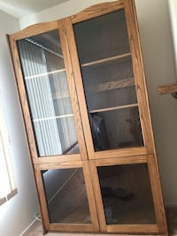 2 brown wooden framed glass cabinet each