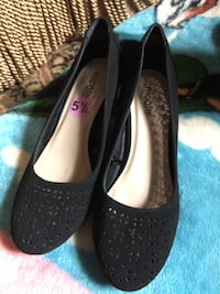 Pair of black suede wedge shoes Arlington