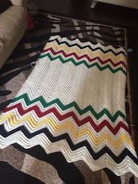 white, green, red, and yellow knit textile