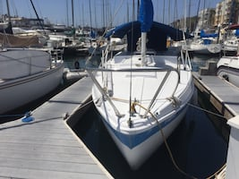white and blue sailing boat