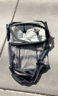 Reversible bassinet and changing table.