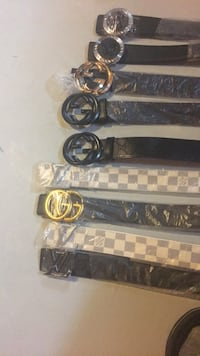 four black and brown leather belts Clarington, L1E 0G4