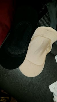 pair of black-and-white slip on shoes Winnipeg, R2X 0B7