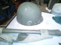 Price negotiable. For Sale WWI OR WWII HELMET AND AXE.