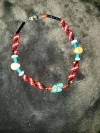 blue, red, and white beaded necklace 2358 mi