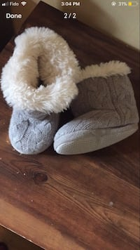 Pair of one year old's gray-and-white knitted fur boots screenshot Montréal, H3N 1Z5
