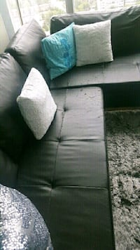 Dark brown leather sectional sofa
