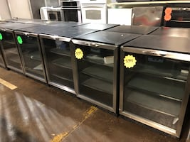 Brand new stainless steel built in wine cooler with 90 day warranty