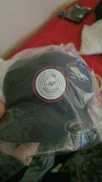 Navy blue rosebowl hat with white and red logo  Pasadena, 91103