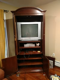 gray CRT television with brown wooden TV hutch Clifton, 07012