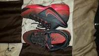 pair of red-and-black Nike basketball shoes