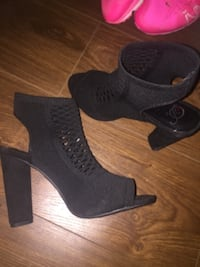 pair of black leather peep-toe heeled booties Surrey