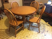 round mocha-brown wooden table with four windsor chairs dining set Sorel-Tracy, J3P 2H3