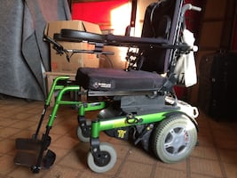 black and green motorized wheelchair