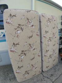 Two twin box spring mattresses