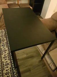 rectangular black wooden coffee table Montréal, H3W 1W9