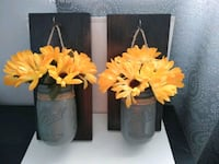 two brown and white flower decors