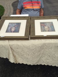 two white wooden photo frames