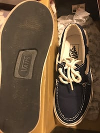 Black-and-white vans off the wall boat shoes with box