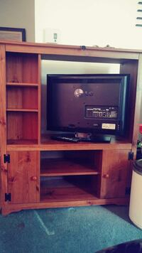 black flat screen TV with brown wooden TV hutch Beauharnois, J6N 3A7
