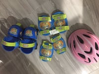 Green-and-blue bicycle gear set and pink bicycle helmet Edmonton, T6V 0J4