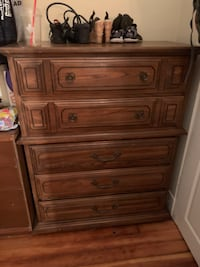 Brown wooden 5 drawer dresser  WINNIPEG
