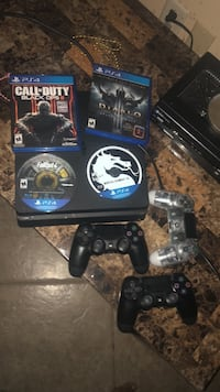 Sony PS4 Original with two controllers and game cases Melbourne, 32935
