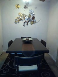 Expandable rectangular brown wooden table w/chairs