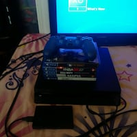 PS4 with games and one controller