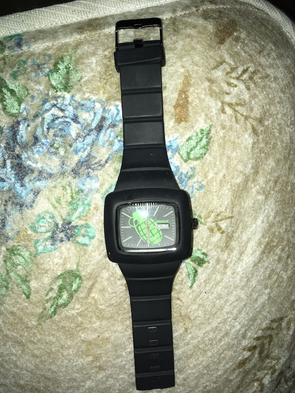 square black analog watch with black strap