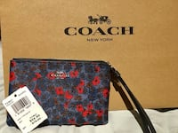 red and blue floral Coach leather wristlet