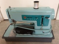 Blue and white sewing machine
