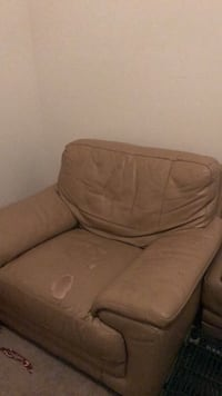 brown fabric 1-seat sofa