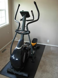 Sportop elliptical E5000 with wooden base board and mat for sale CALGARY