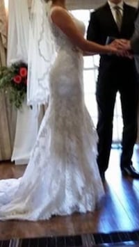 """Essence of Australia wedding dress. All lace. Was over $3,000 new. Fits size 6. For heights of 5'4"""" to 5'6"""" depends on high heels. Ivory colour dress. Mississauga, L5J 3H3"""