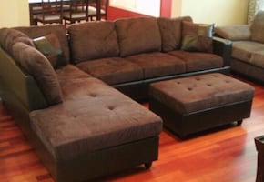 Brown microfiber sectional couch and storage ottoman
